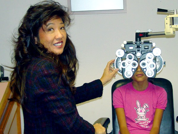 Optometrist with child patient